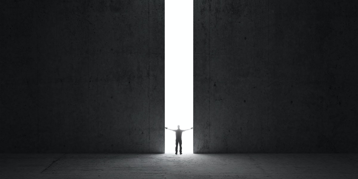 Man stands in the light of opening