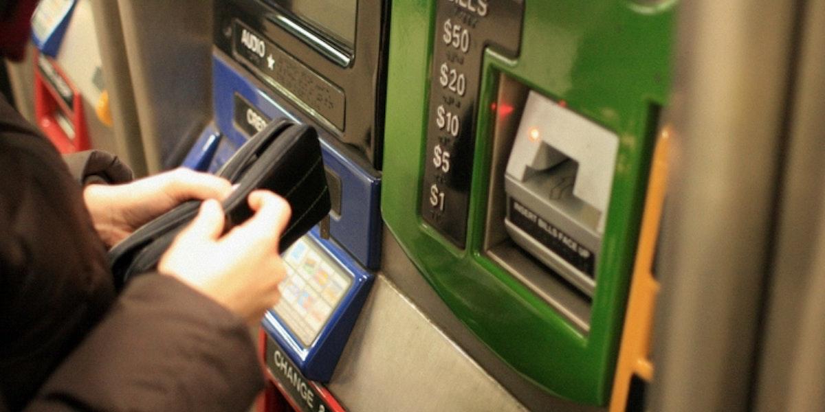 Woman Buying Metrocard - New York City