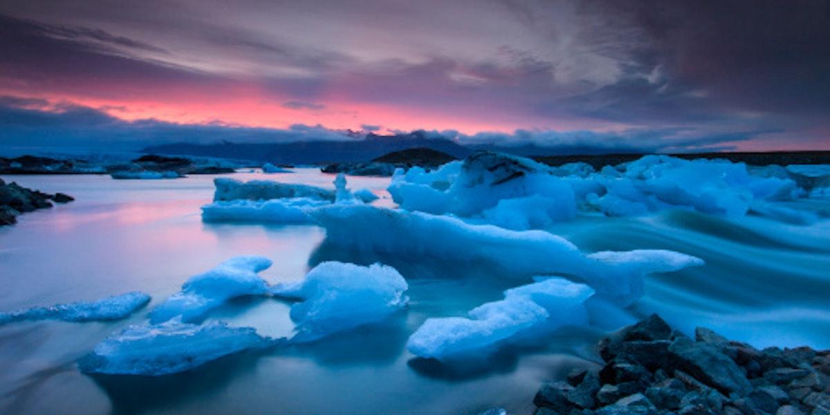 Icebergs floating in Jokulsarlon glacier lake at sunset