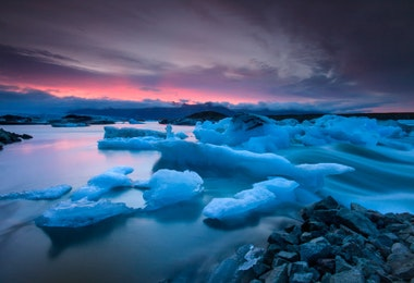 Icebergs floating in Jokulsarlon glacier lake at sunset