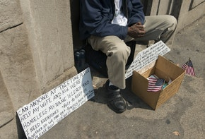 Beggar sitting on the ledge, Chicago, Cook County, Illinois, USA