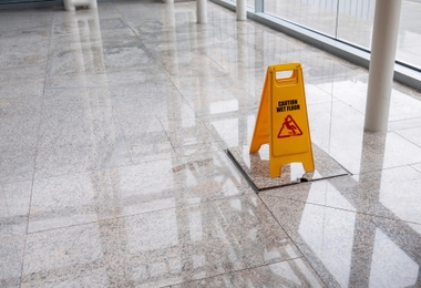 wet floor sign on lobby