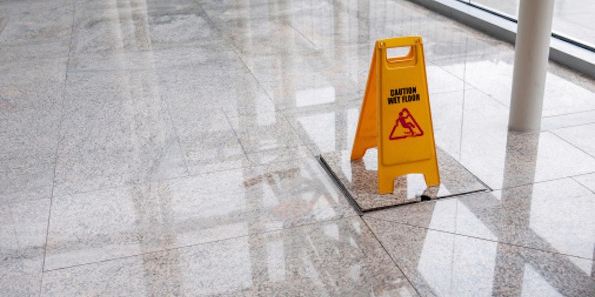 wet floor sign on lobby