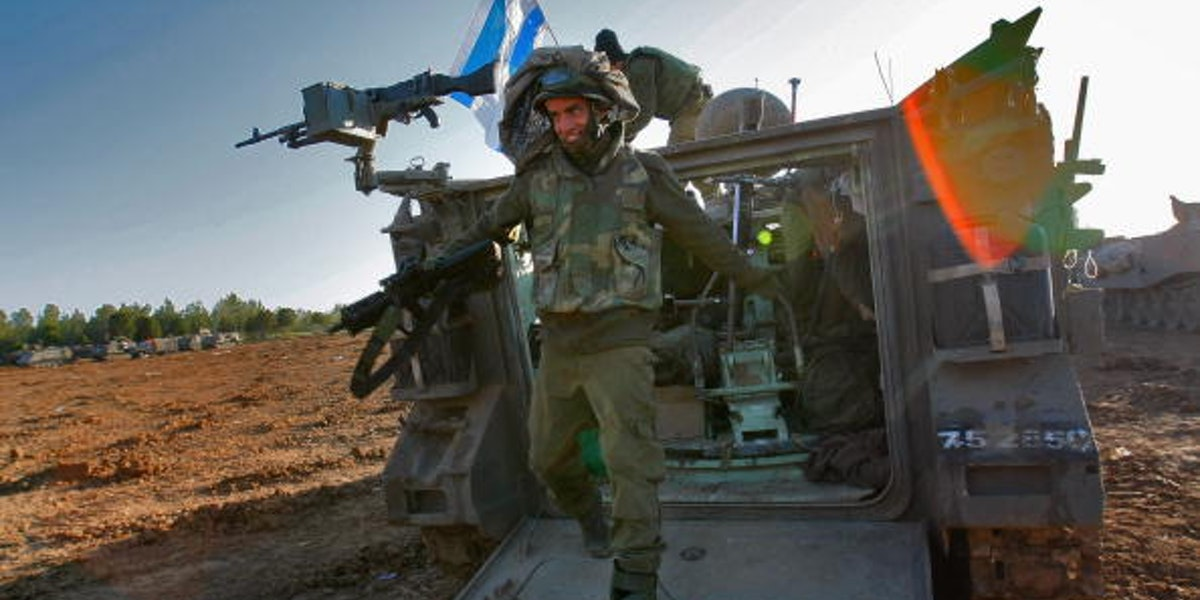 GAZA BORDER, ISRAEL - JANUARY 13:  An Israeli soldier dismounts from an APC after returning from fighting against Hamas militants in the Gaza Strip on January 13, 2009 at a forward deployment area on Israel's border with the Palestinian territory. Israel is intensifying its wide-scale ground assault against the Gaza Strip in an effort to put an end to Hamas rocket attacks against the Jewish State.  (Photo by David Silverman/Getty Images)