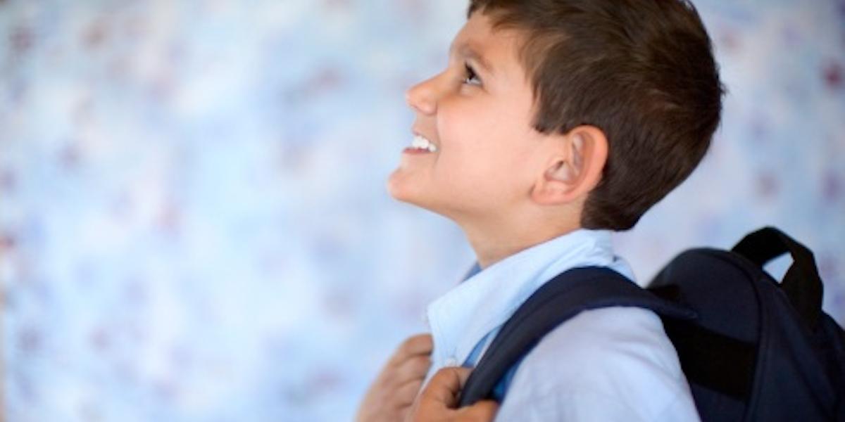 Smiling Boy Ready for School