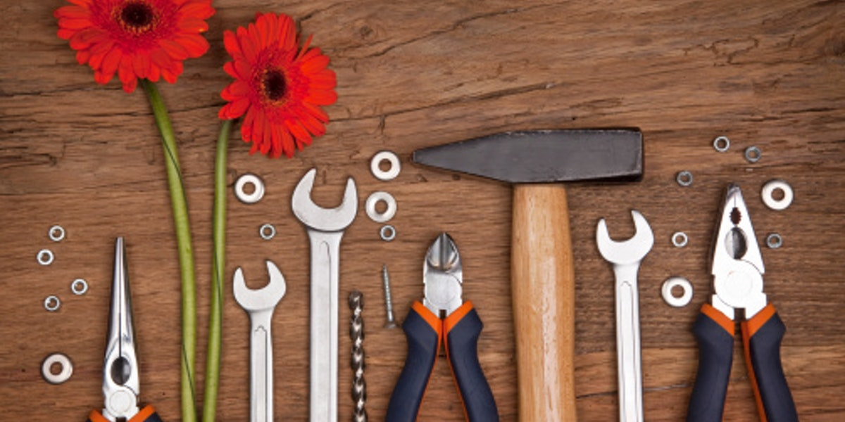 Set of different tools with flowers