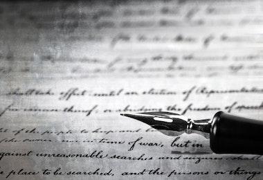 vintage pen on a handwritten paper