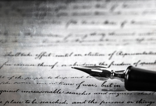 vintage pen on a handwritten paper