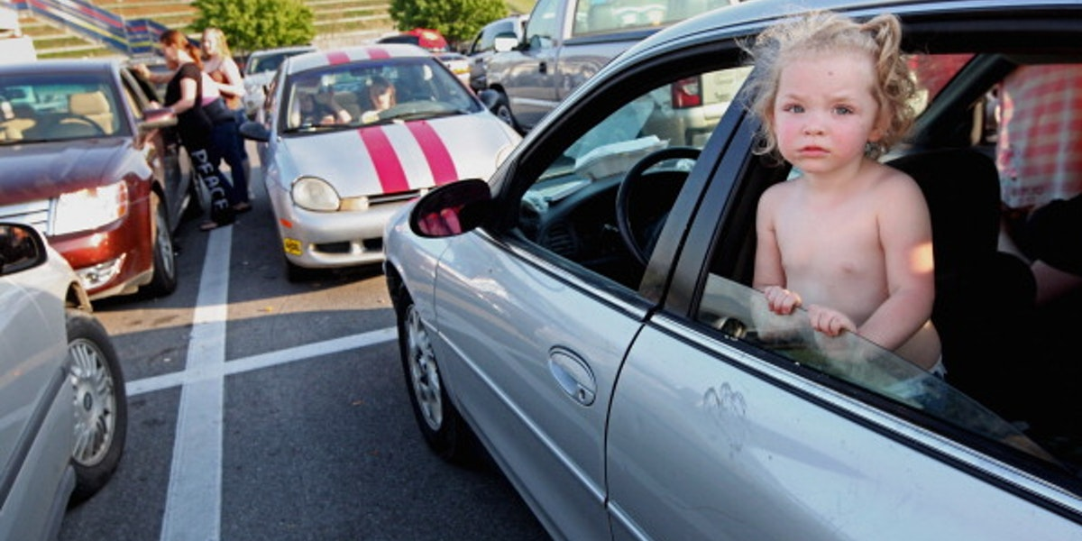 BRISTOL, TN - APRIL 14:  Natalie Kiser stands in her parents' car as they prepare to wait overnight in the parking lot to attend the Remote Area Medical (RAM) free clinic at the Bristol Motor Speedway, located in the mountains of Appalachia, on April 14, 2012 in Bristol, Tennessee. Around two thousand uninsured and underinsured are expected to receive free medical, dental, vision and pulmonary treatments provided by volunteer doctors, dentists, optometrists, nurses and support staff during the three day clinic in the foothills of the Appalachian Mountains, one of the poorest regions in the country. The U.S. Supreme Court recently heard arguments over the constitutionality of President Obama?s sweeping health care overhaul. (Photo by Mario Tama/Getty Images)