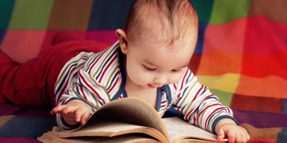 cute little baby reading book