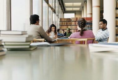 Surface Level Shot of Mature Students Sitting at a Table in a University Library