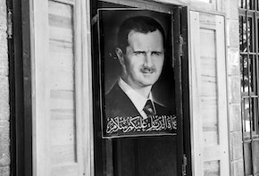 Damascus, Syria - June 15, 2010: A poster of Syrian President Bashar al-Assad hangs outside a shop in central Damascus.