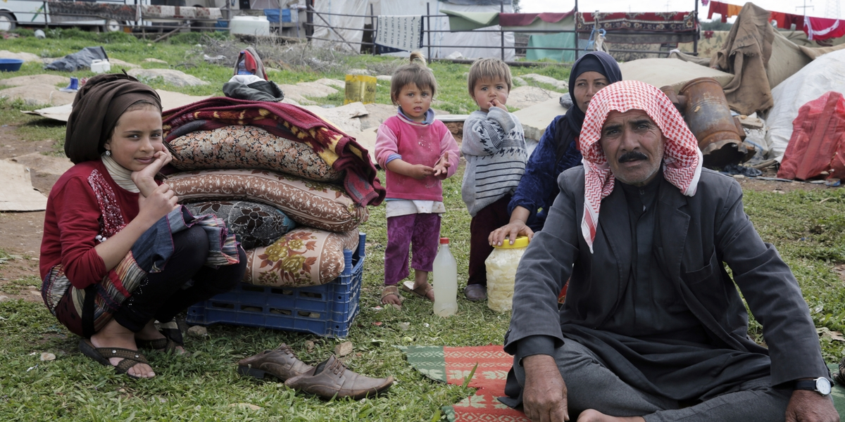 Izmir, Turkey - March 11, 2016: A Syrian family in refugee camp in Izmir,Turkey. These people are refugees from Haleppo and escaped because of Syrian war.