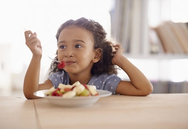 Shot of a cute little girl eating fruit salad at a tablehttp://195.154.178.81/DATA/i_collage/pi/shoots/783539.jpg