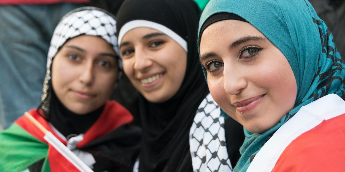 Philadelphia, PA, USA- July 27, 2014: Muslim young women posing at an anti Gaza Israeli bombardment demonstration at Philadelphia downtown