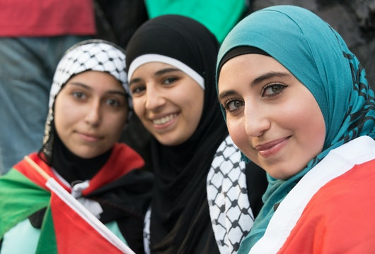 Philadelphia, PA, USA- July 27, 2014: Muslim young women posing at an anti Gaza Israeli bombardment demonstration at Philadelphia downtown