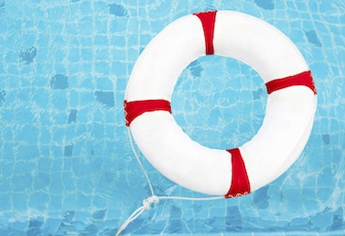 Life Ring at the swimming pool. Life Ring on water. Life Ring on blue water.