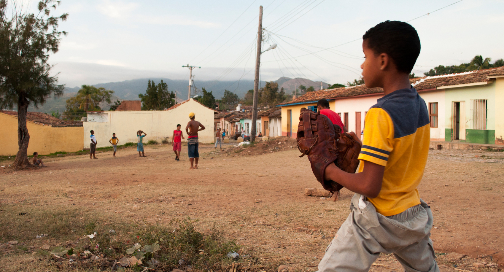 Kids playing baseball in a plot in a small village of Trinidad, Cuba.