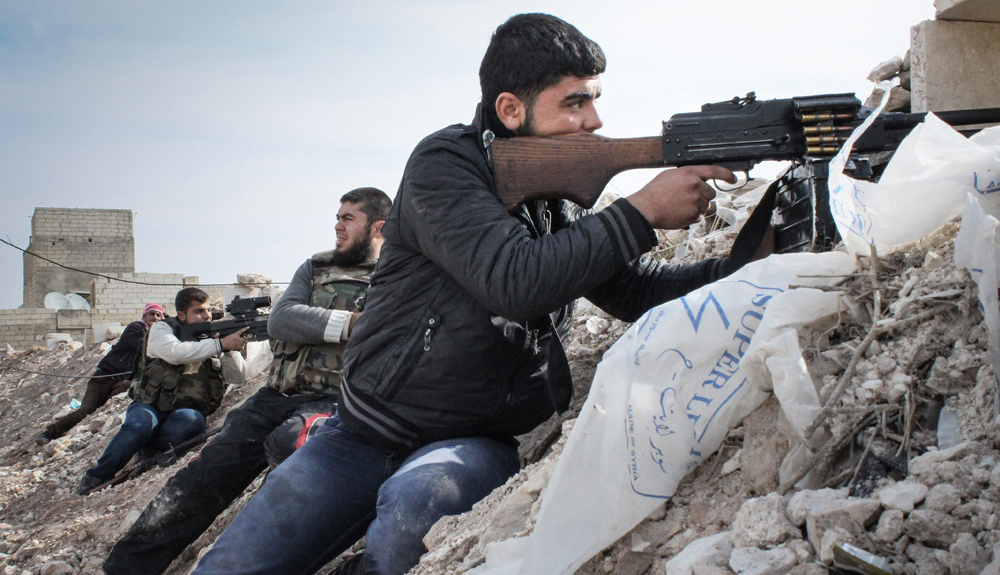 Free Syrian Army rebels fighting against Assad militias on the outskirts of the northwestern city of Maraat al-Numan, Idlib - Syria. Source: Freedom House.