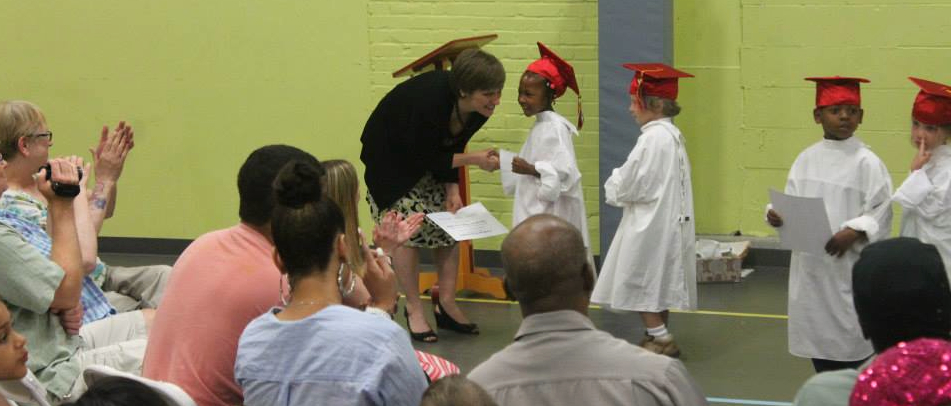 City Garden Montessori Charter School Executive Director Christie Huck awarding graduates. Source: City Garden Montessori Charter School.