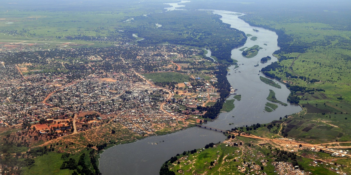 Aerial of Juba, the capital of South Sudan, with the river Nile running in the middle. Juba downtown is upper middle close to the river, and the airport can be seen upper left. The picture is from the south to the north.