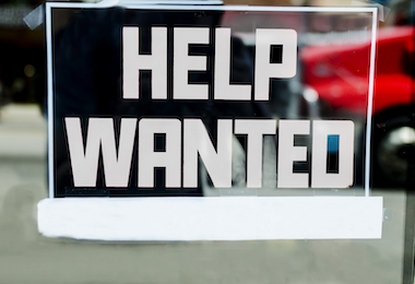 Help wanted sign outside of a store in the United States.