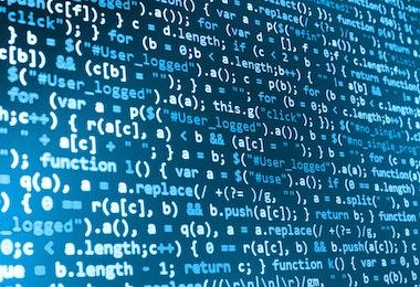 Software developer programming code on computer. Abstract computer script source code.