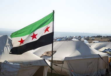 Free Syrian flag flying inside the camp for displaced persons at Atmeh, Syria