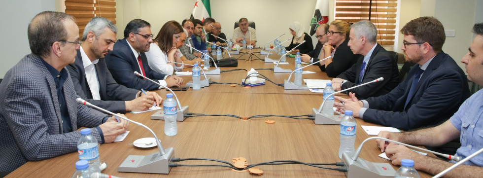 """U.S. Special Envoy Michael Ratney meets with civilian representatives of Syrian opposition."""" Source: National Coalition of Syrian Revolution and Opposition Forces. Source:"""