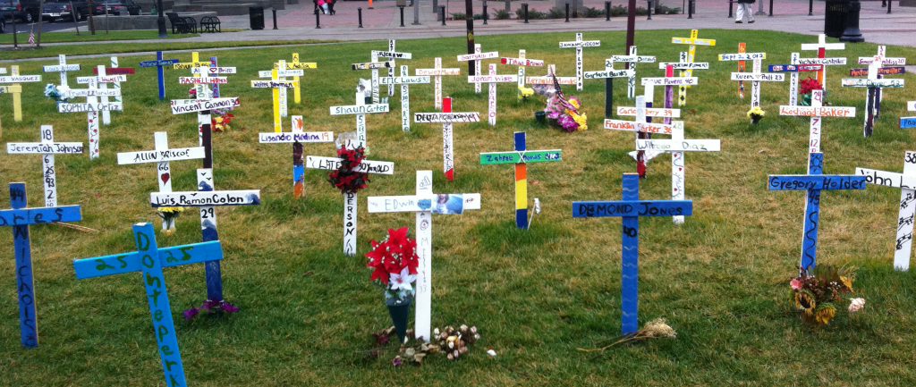 Crosses outside of XXXX, each representing a person murdered in Camden in 2012, mostly young black men. Source: Photo taken by author.