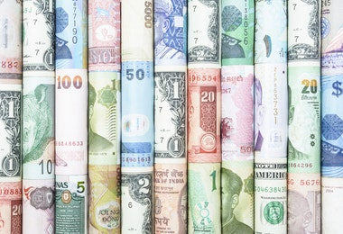 A backgrounds with colorful of many roll curreny from many country