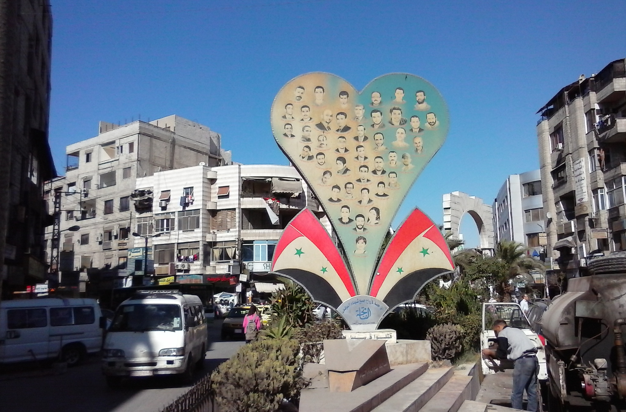 A monument to victims of a 2014 car bomb in President's Square in Jeremana, a Damascus suburb.