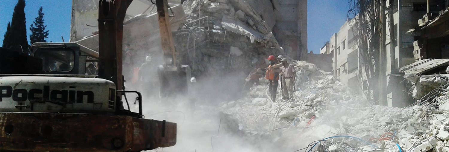 Civil Defense team works to pull bodies from scene of airstrike.
