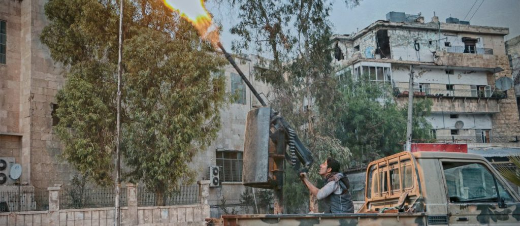 Rebel inside Aleppo city fires at planes overhead