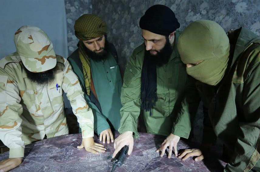 Fateh al-Sham Front head Abu Muhammad al-Jolani meets with commanders to discuss battle for Aleppo. Source: @dlockyer.