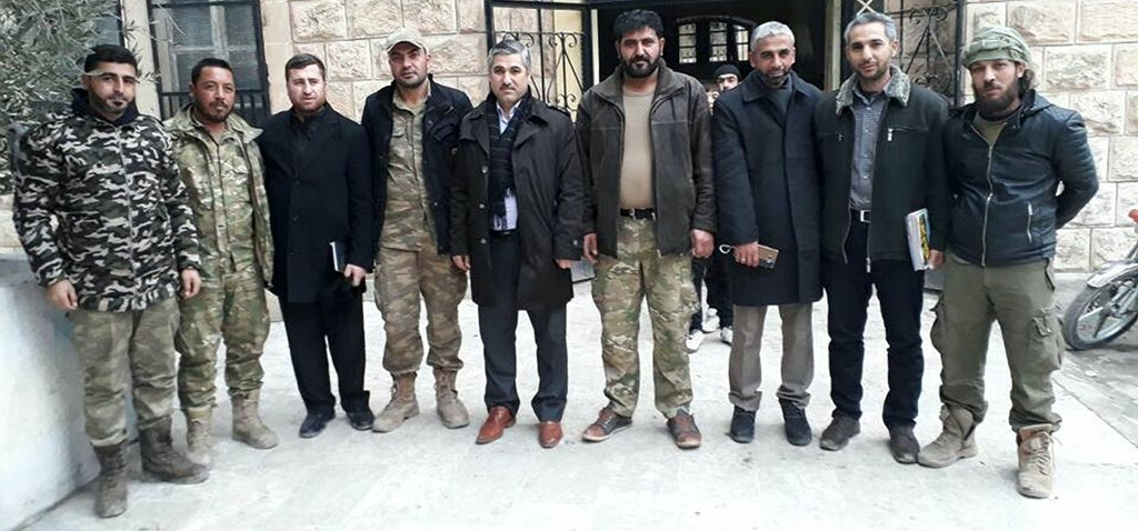 Members of the Manbij Revolutionary Council meet with the education minister of the Syrian Interim Government in early 2017. © Facebook/Manbij Revolutionary Council