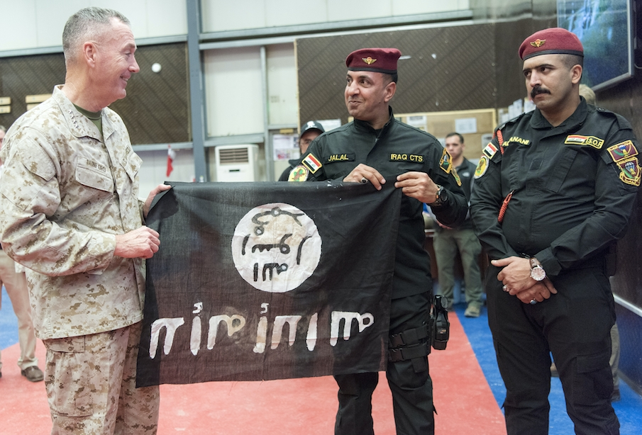 Members from the Iraqi Counter Terrorism Service present Marine Gen. Joseph F. Dunford, chairman of the Joint Chiefs of Staff, with a flag from Bartilah, a town recaptured just outside of Mosul from the Islamic State of Iraq and the Levant. This flag symbolizes the efforts of Combined Joint Task Force - Operation Inherent Resolve composed of U.S. Army Soldiers, U.S. Marine Corps Marines, U.S. Navy Sailors, United States Air Force Airmen and coalition military forces. (DoD Photo by Navy Petty Officer 2nd Class  Dominique A. Pineiro/released)