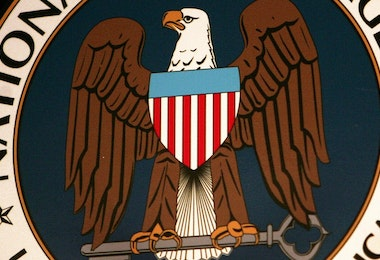 Fort Meade, UNITED STATES:  (FILES): Thyis 25 January 2006 file photo shows the logo of the National Security Agency (NSA) at the Threat Operations Center inside the NSA in the Washington suburb of Fort Meade, Maryland, where US President George W. Bush delivered a speech behind closed doors and met with employees in advance of Senate hearings on the much-criticized domestic surveillance. The US National Security Agency has assembled the world's largest database of telephone records tracking the phone calls of tens of millions of AT and T, Verizon and BellSouth customers, sources familiar with the program told USA Today.  In an article published 11 May 2006, the daily said the NSA launched the secret program in 2001, shortly after the 11 September 2001 attacks, to analyze calling patterns in a bid to detect terrorist activity.  AFP PHOTO/FILES/Paul J. Richards  (Photo credit should read PAUL J. RICHARDS/AFP/Getty Images)