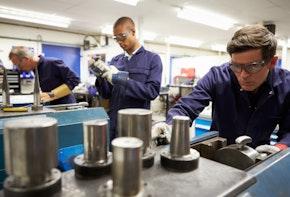 Busy Interior Of Workers In Engineering Workshop