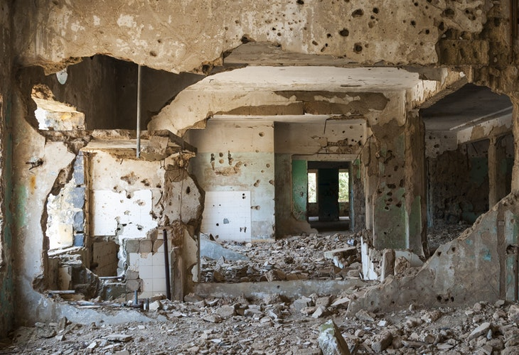 Interior view of the abandoned and bullet-scarred hospital in Quneitra, Syria. Quneitra was occupied by Israel for seven years beginning in 1967. Today, though decades have passed since the Israeli withdrawal, the town has been left in its destroyed state.