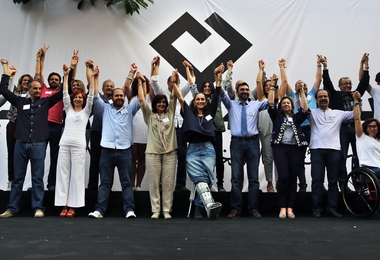 In this Saturday, April 30, 2016 photo, members of Beirut Madinati, an electoral list for the upcoming Beirut municipality polls, raise their hands during an election rally in Beirut, Lebanon. (AP Photo/Bilal Hussein)