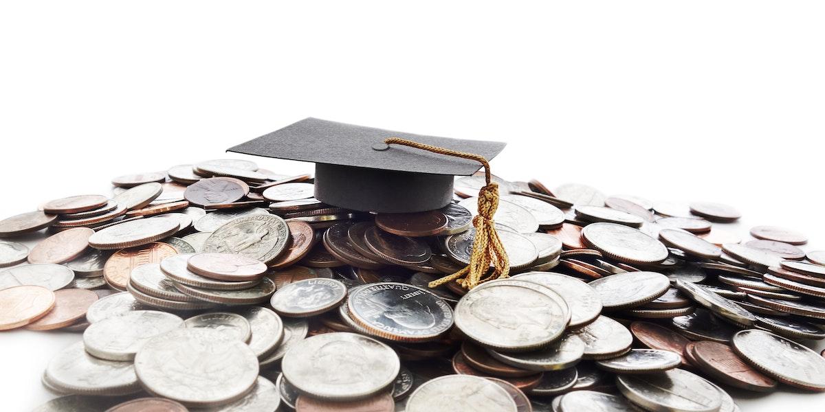 Graduation cap on a pile of money -- student loan concept