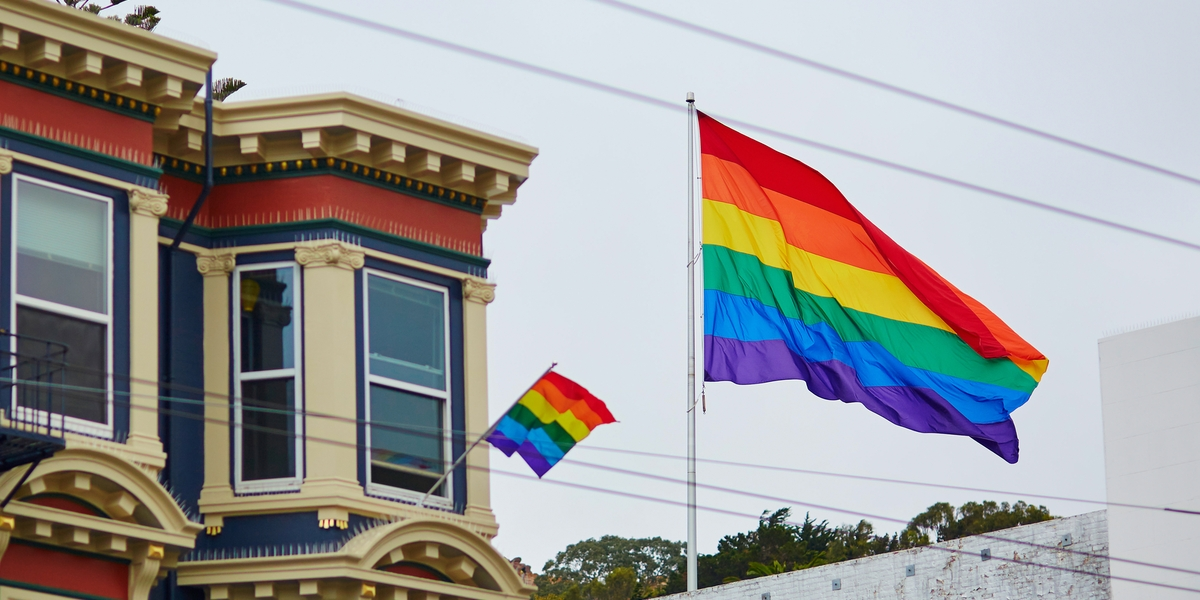 Gay Pride Movement flag on a street of San Francisco, California, USA