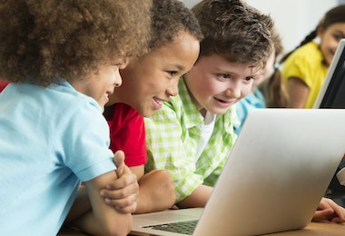 Preschool children looking on a laptop