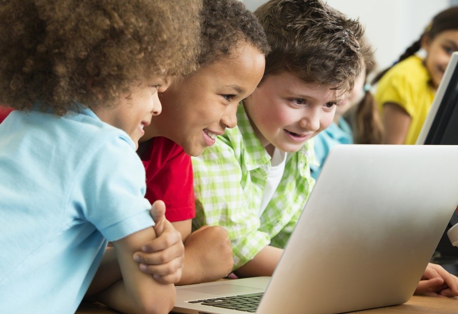 Preschool children looking on a laptop
