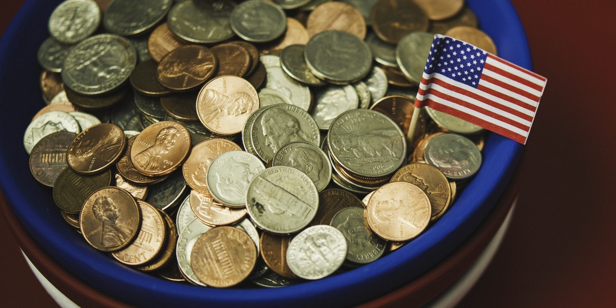 Bowl filled with cash in patriotic colors. Charity and donation theme