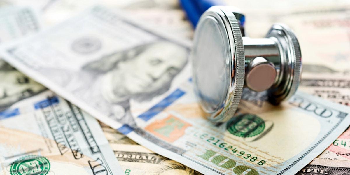Stethoscope over the dollar bills.