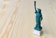 American symbol - Statue of Liberty. New York, USA on wooden table with background.American symbol - Statue of Liberty. New York, USA on wooden table with background.
