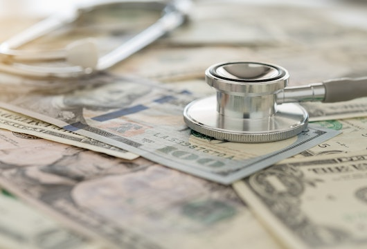 medical cost, stethoscope on dollar banknote money. concept of health care costs, finance, health insurance fund.