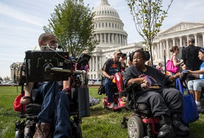 WASHINGTON, DC - SEPTEMBER 26: People in wheelchairs, from the group ADAPT, wait for senators to arrive for a news conference in opposition to the Graham-Cassidy health care bill, September 26, 2017 in Washington, DC. The Graham-Cassidy bill, the GOP's latest effort to repeal the Affordable Care Act (ACA), is in peril after Sen. Susan Collins (R-ME) announced her opposition to the bill on Monday night. (Photo by Drew Angerer/Getty Images)